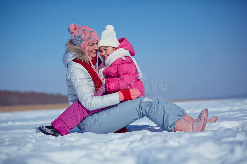 Playing with child. Happy young women and her cute daughter having fun stock image