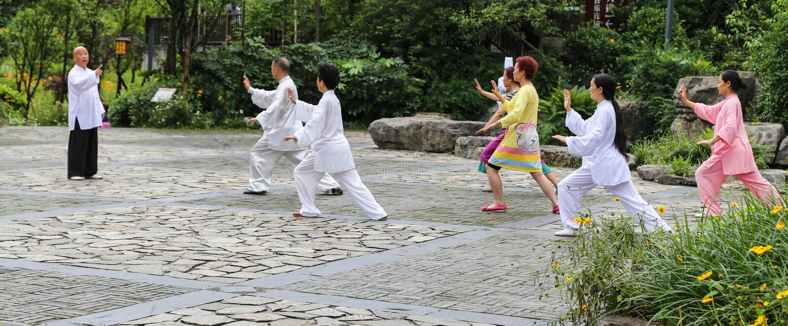 Playing chinese shadow boxing in qili town,mount emei,shichuan,china stock image