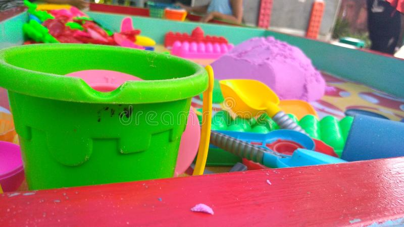 Playing colour sand in family holiday. Playing colour sand family holiday stock photo