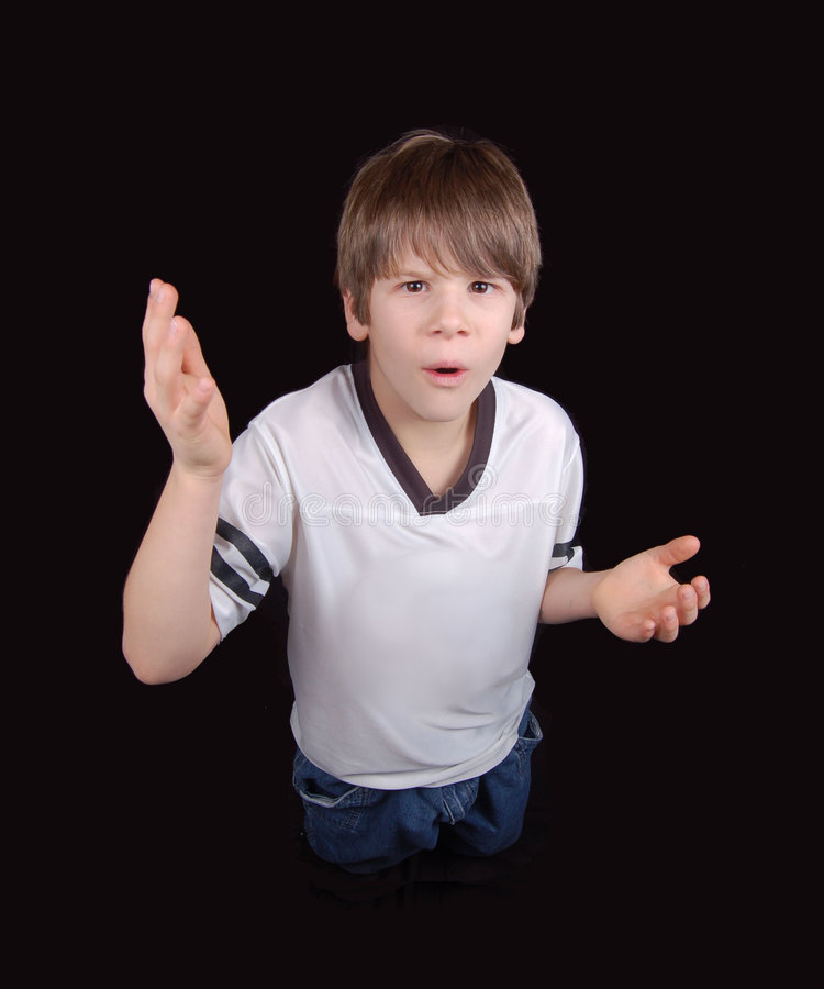 Playing Confused. This boy asks 'what did I do?' acting all innocent. Can he pull the wool over your eyes? Is he innocent, guilty, shocked, or in a state of stock photography