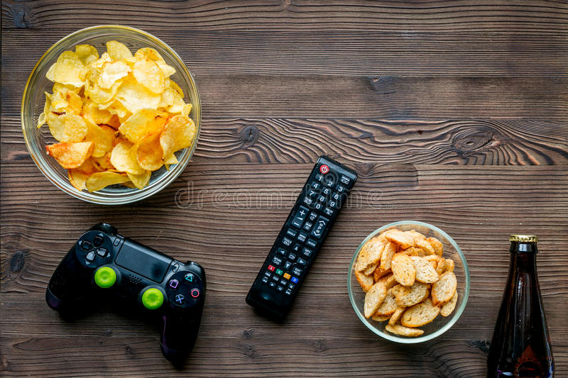 Download Playing Console Concept With Chips On Wooden Background Top View  Mock Up Stock Image