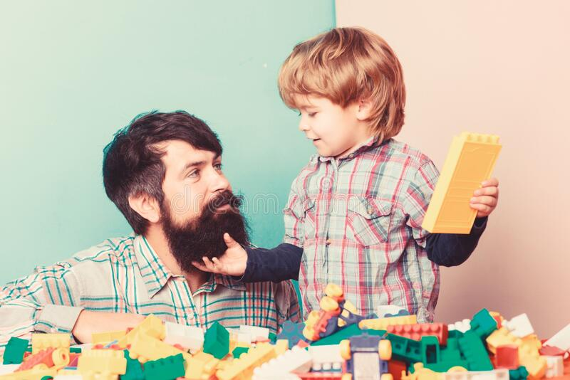 Playing with daddy. building home with constructor. child development. happy family leisure. father and son play game stock photography