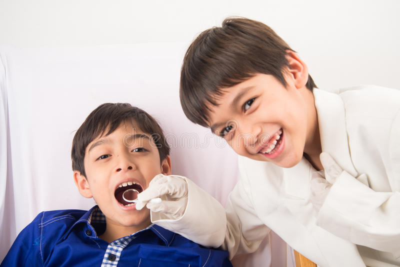 Playing dentists day stock image