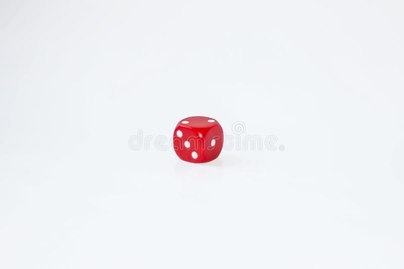 A playing dice with a white background with the faces of one of two and three facing the camera.  royalty free stock photography