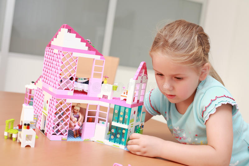 Playing with doll's house royalty free stock images