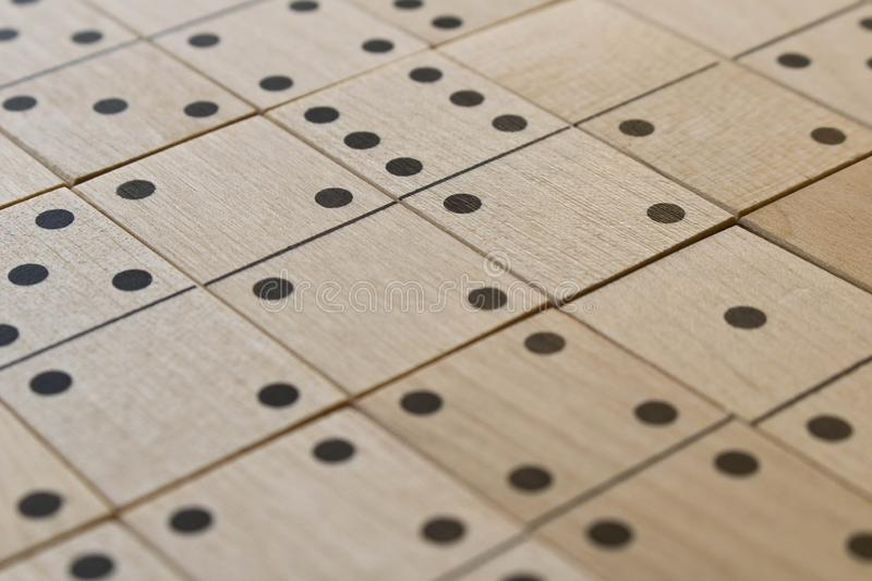Playing dominoes on a wooden table. Leisure games concept. Domino abstract background. Selective focus royalty free stock photography