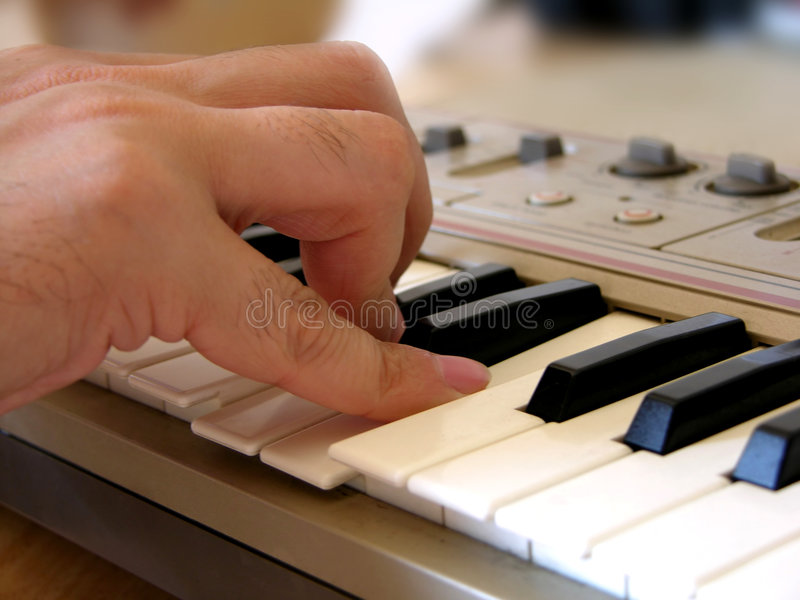 Playing electric synthesizer stock image