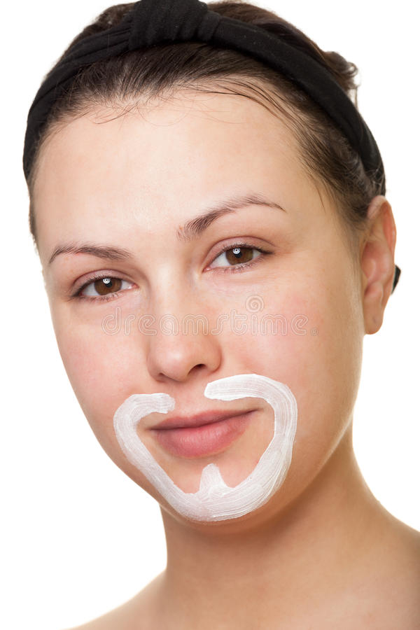 Playing with face cream. Making moustache and beard with face cream stock photography