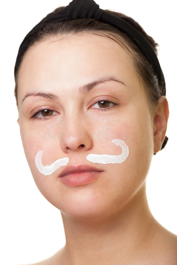 Playing with face cream. Making moustache and beard with face cream stock photos