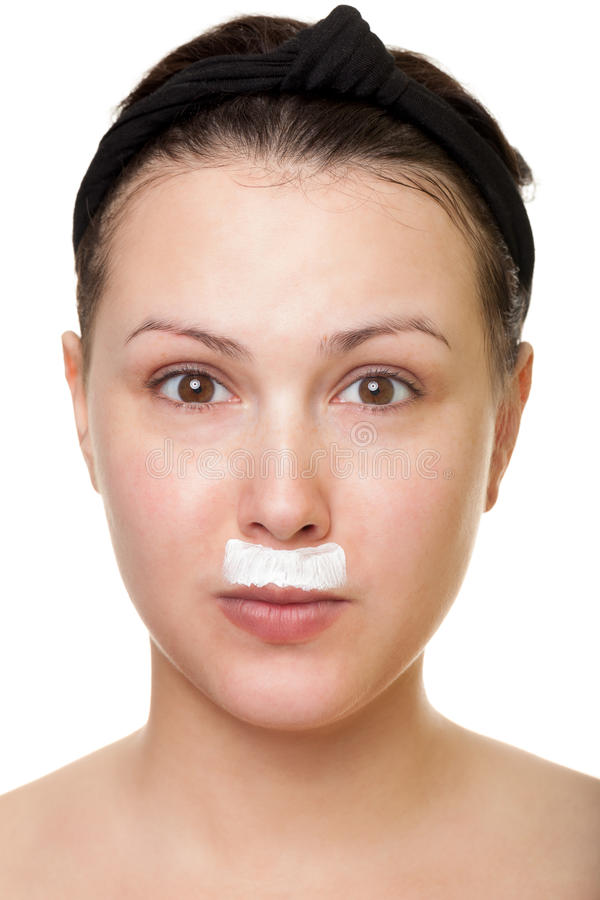 Playing with face cream. Making moustache and beard with face cream royalty free stock image