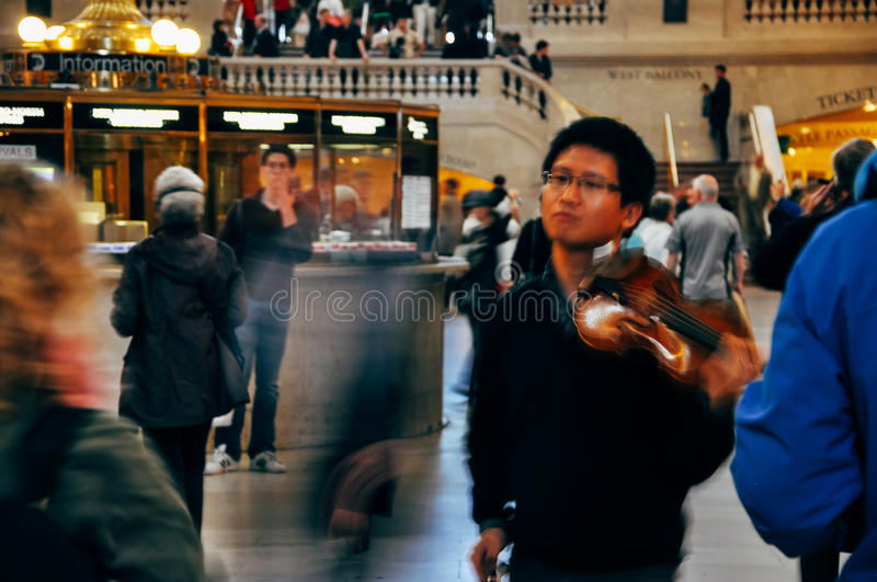 Playing the fiddle in Grand Central Terminal. royalty free stock image