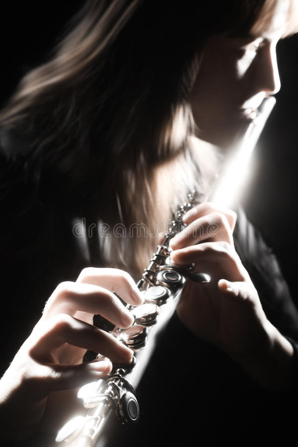 Playing flute player royalty free stock images