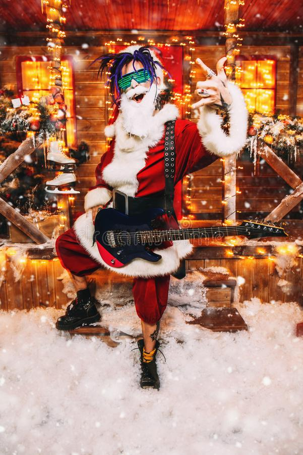 Playing the guitar for christmas stock photo