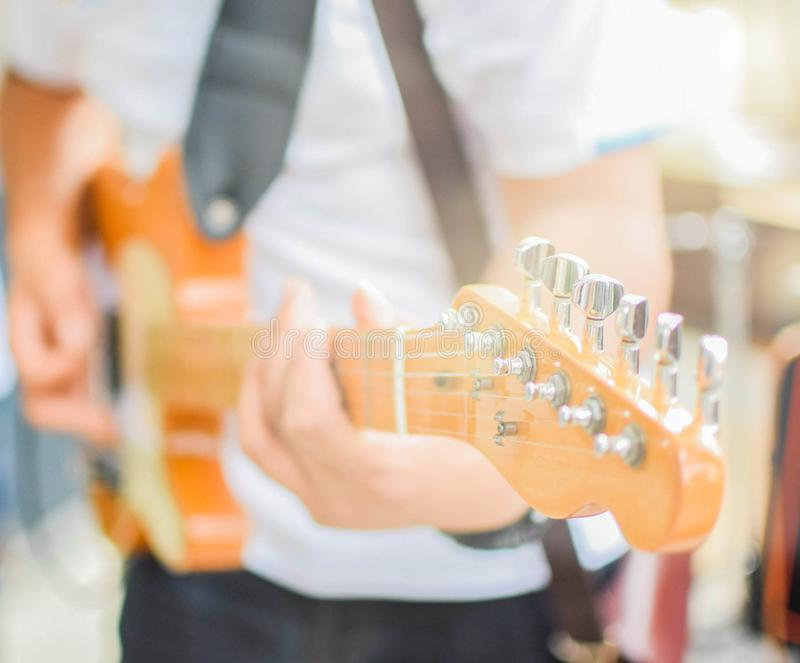 Playing guitar for men stock photography