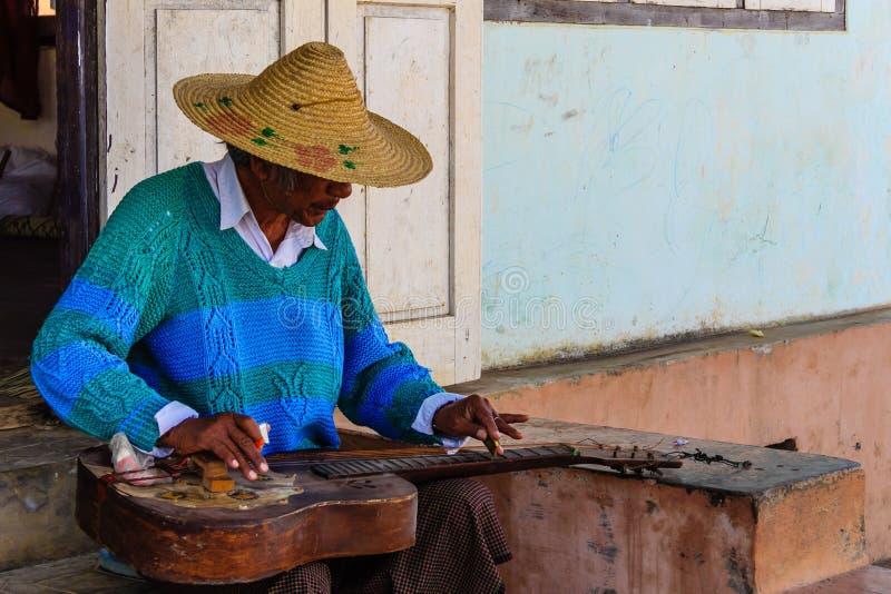 Playing Guitar ,Nyaung Shwe in Myanmar (Burmar). Burmese is Playing Guitar ,Nyaung Shwe in Myanmar (Burmar stock image
