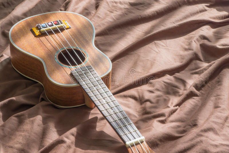Playing guitar or Ukulele chord royalty free stock images