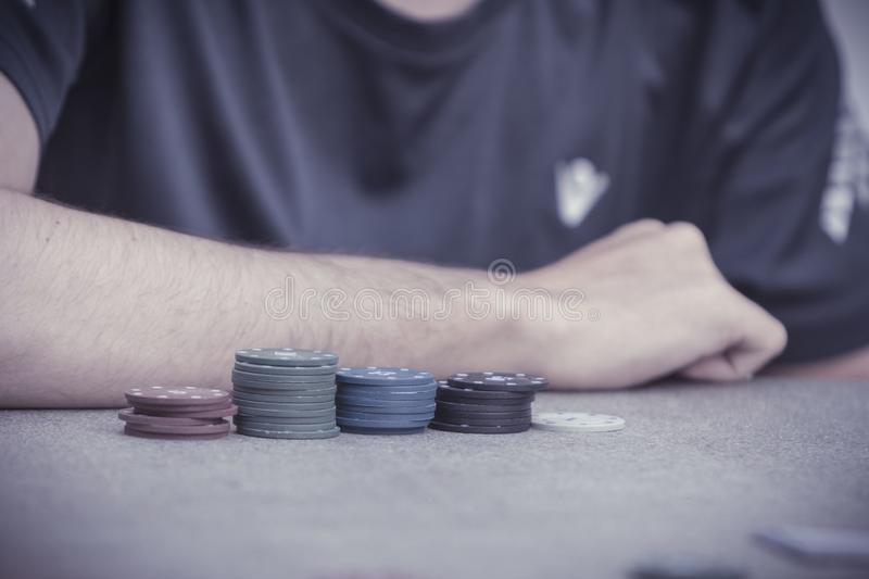 Playing a hand of Texas Hold`em poker royalty free stock photo