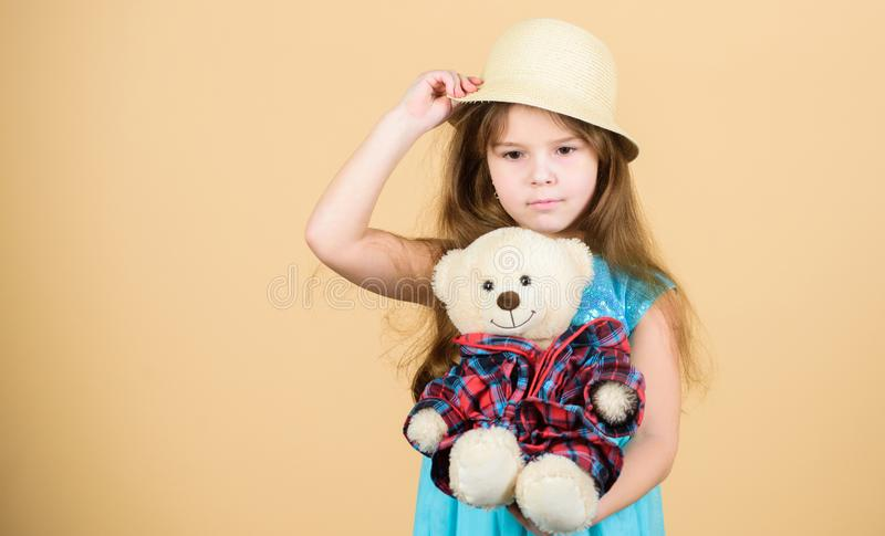 Playing with her favorite toy. Little girl holding soft toy. Small child cuddling teddy bear toy. Adorable girl child stock photography