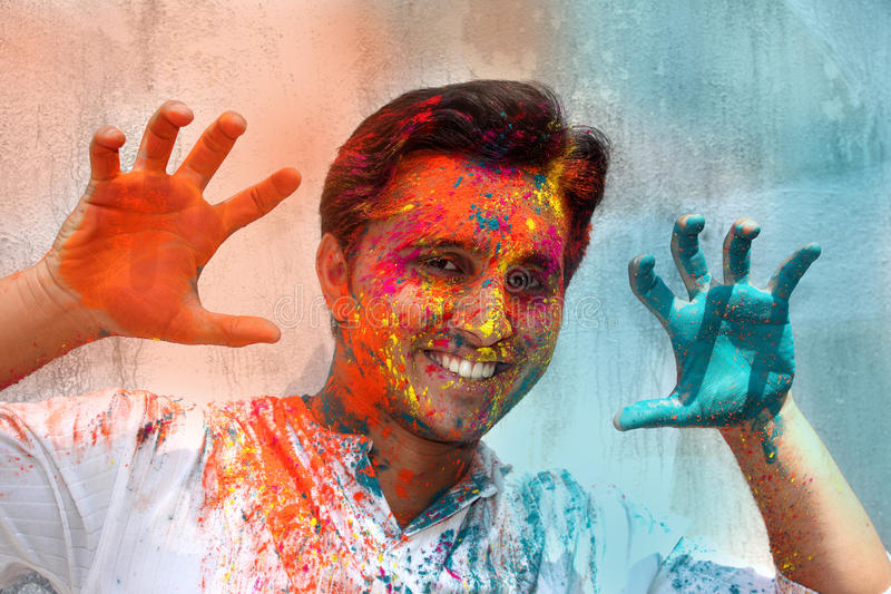 Playing Holi. A young Indian guy having fun in Holi festival royalty free stock photos