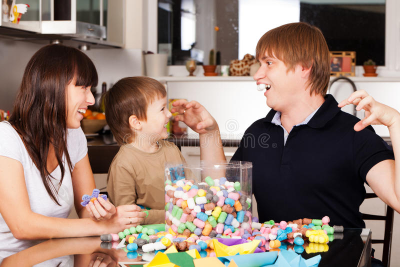 Playing at home. Father is showing funny rabbit to wife and son stock images