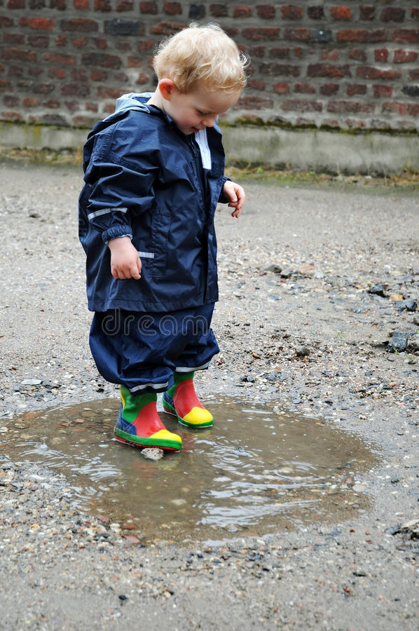 Free Playing In A Puddle Royalty Free Stock Image - 25613856