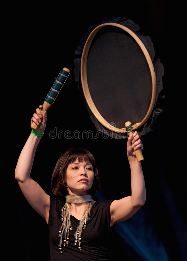 Playing Inuit Drum. OTTAWA, CANADA - JUNE 10: Charlotte Qamaniq-Mason of the group Tumavut, plays a traditional inuit drum in a performance at Westfest in Ottawa stock images