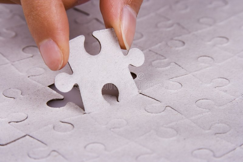 Playing Jigsaw Puzzle stock image
