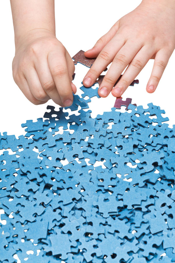 Playing with jigsaw puzzles isolated. On white background stock image