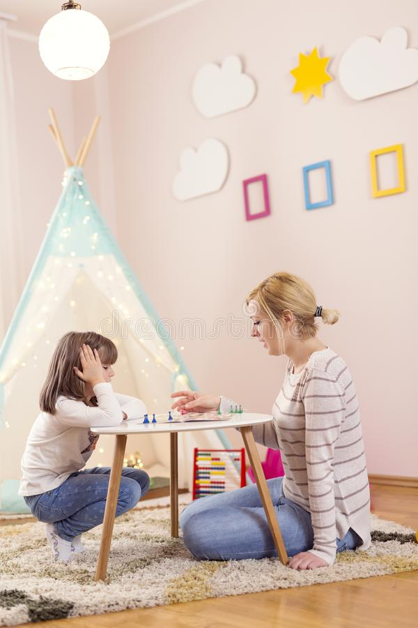 Playing a ludo game royalty free stock photo