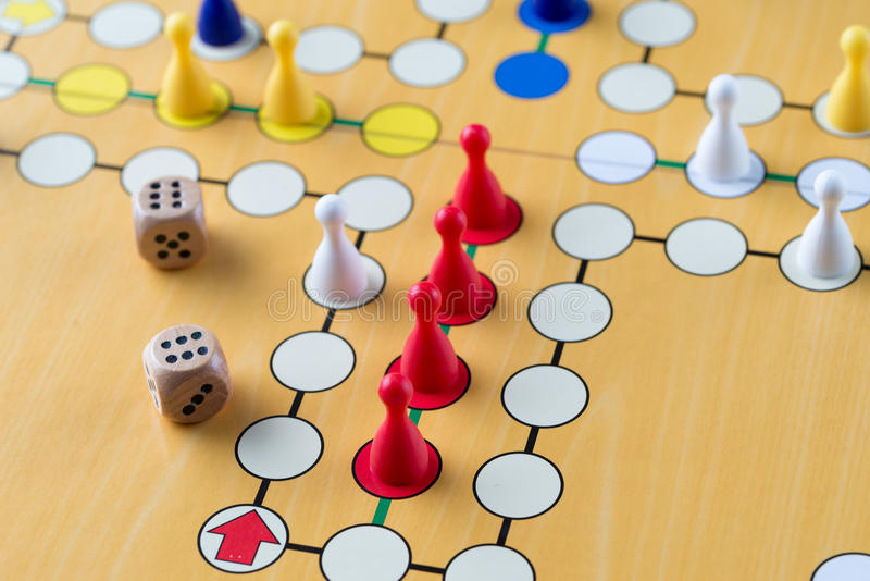 Playing ludo game with two dices. Closeup detail. Board game ludo with two dices. Red won. Studio photography royalty free stock photo