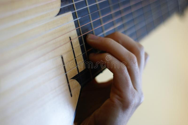 Playing the lute right hand. Right hand playing the lute stock image