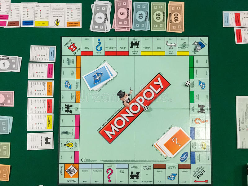 Playing Monopoly Board Game. BUCHAREST, ROMANIA - JANUARY 01, 2016: Monopoly is a board game that originated in the United States in 1903 and the current version stock photos