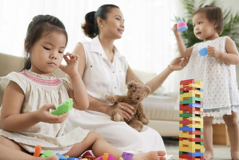 Playing mother and children stock photography