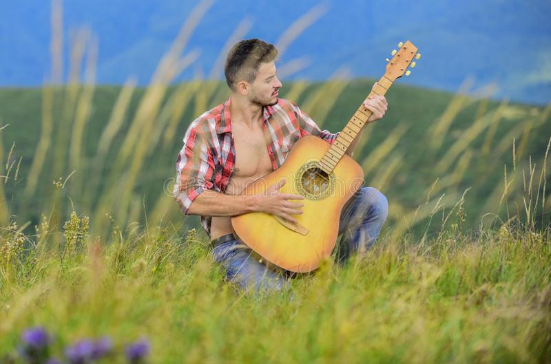 Playing music. Sound of freedom. Inspired musician play rock ballad. Compose melody. Inspiring environment. Man with. Guitar on top of mountain. Acoustic music royalty free stock photos
