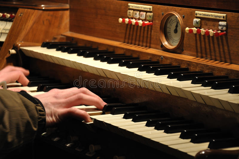 Playing organ royalty free stock photo