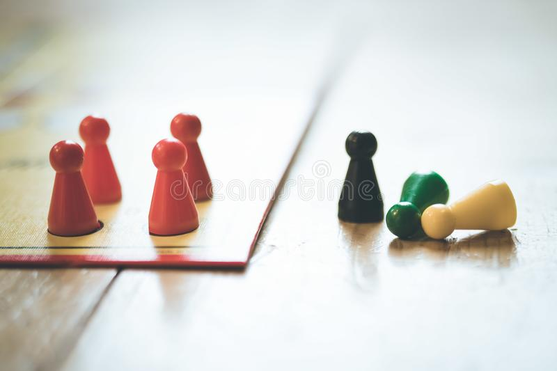 Playing a parlor game: Meeples on a table, ludo stock images