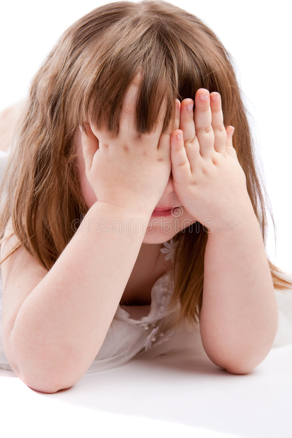 Playing peek-a-boo. Girl playing peek-a-boo, isolated stock images