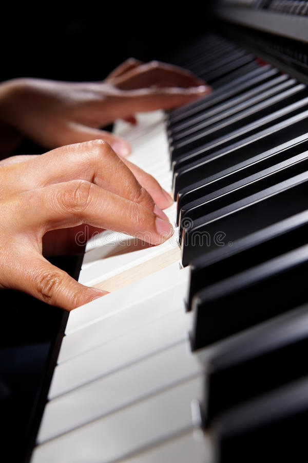 Download Playing pianno stock photo. Image of hand, piano, playing - 20229718