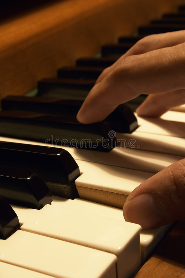 Playing The Piano stock photo