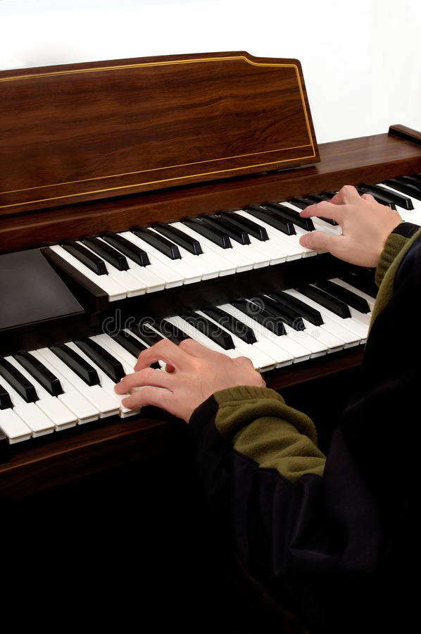 Playing the piano. Musical instrument. hands playing the piano and electronic organ stock photography