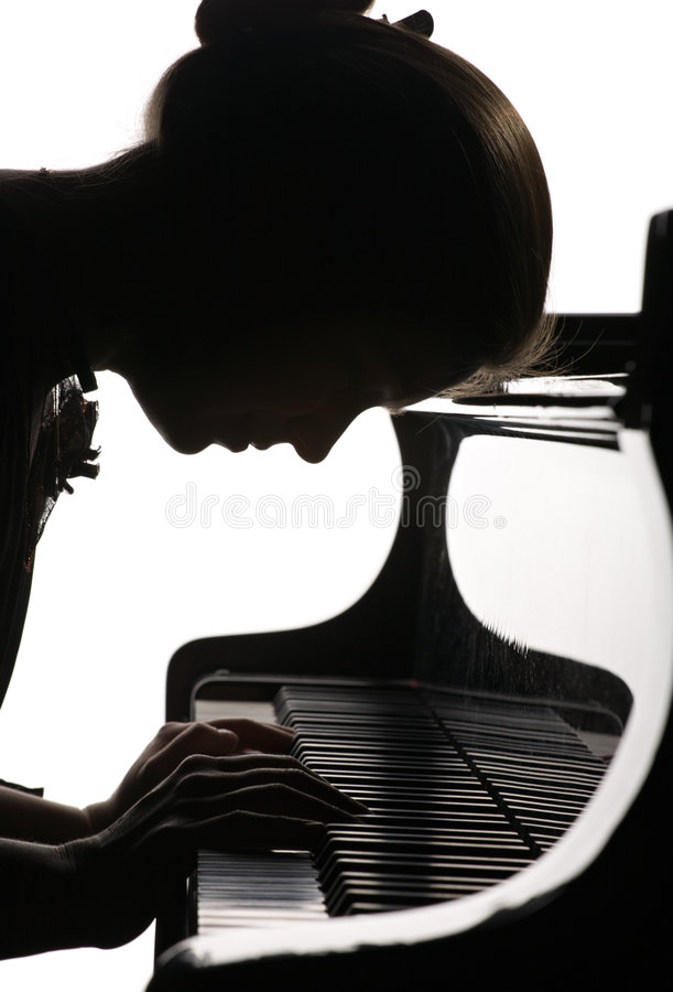 Playing the piano royalty free stock image