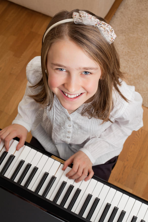 Playing the piano at home royalty free stock photo