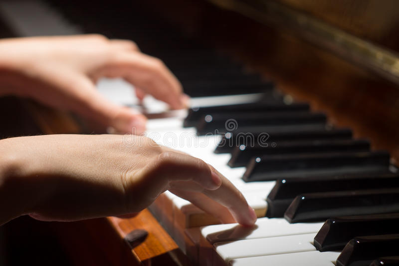 Playing on piano keyboard royalty free stock photography