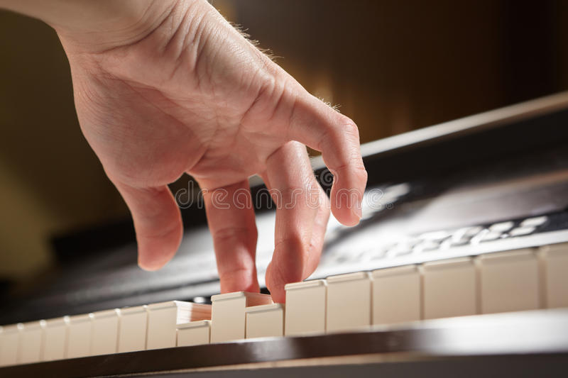 Download Playing Piano From Low Angle Stock Photo - Image: 20163636