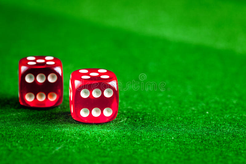 Playing poker dice on green background. Close up stock photos