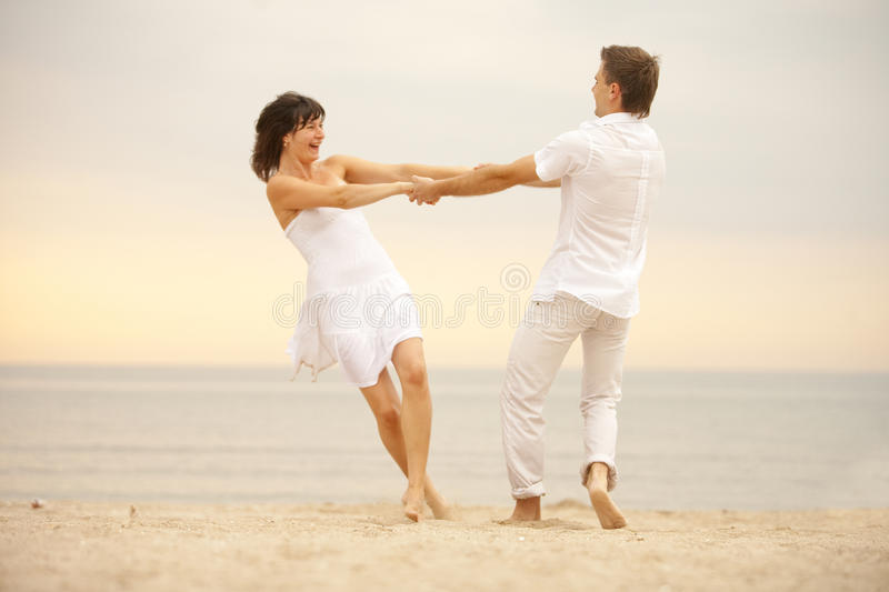 Download Playing on the sand stock photo. Image of dusk, love - 10570992