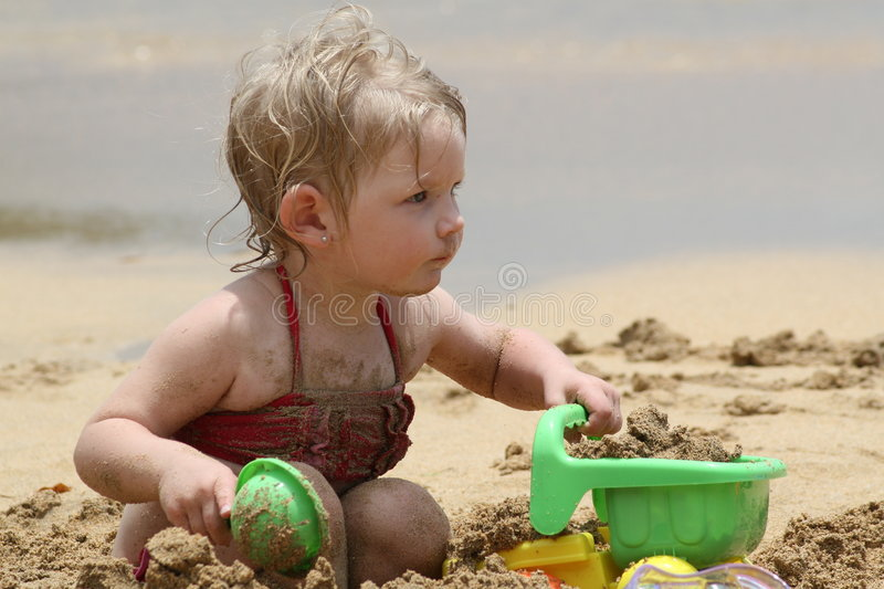 Playing in the sand stock photos