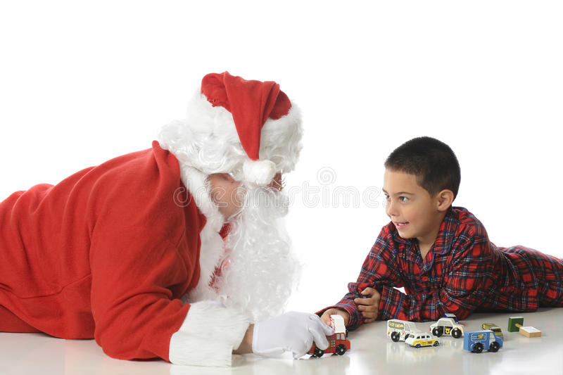 Playing with Santa royalty free stock images