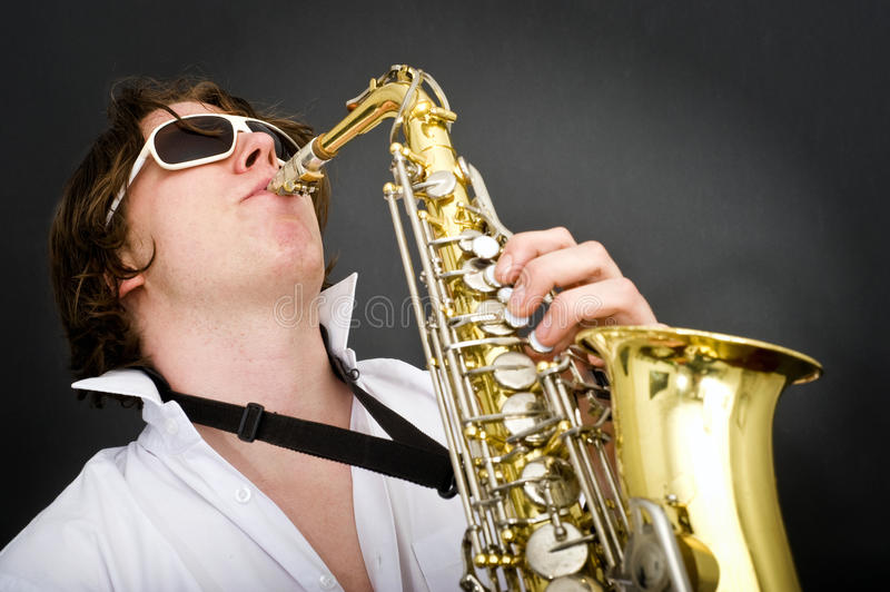 Playing the Saxophone. Striking the high note on a saxophone stock image