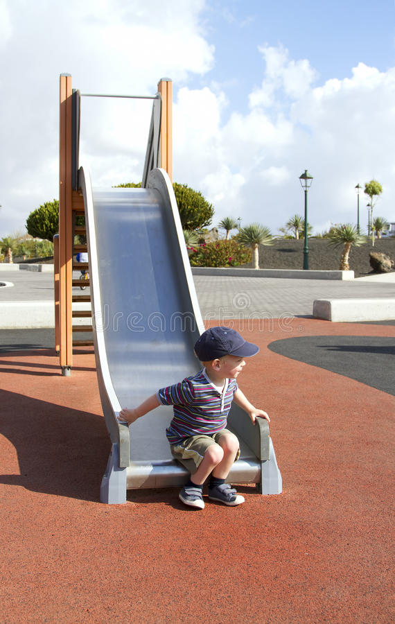 Download Playing on a slide stock image. Image of childhood, cheerful - 24230815